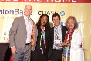 Channa Grace (right) receiving Homes Within Reach Developer of the Year award from SCANPH