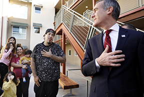 Mayor Eric Garcetti, right, shares a moment with the Ayala family